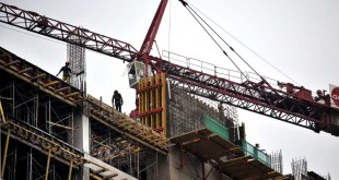 Indonesian laborers work at a building c